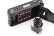 Open back on film camera over white
